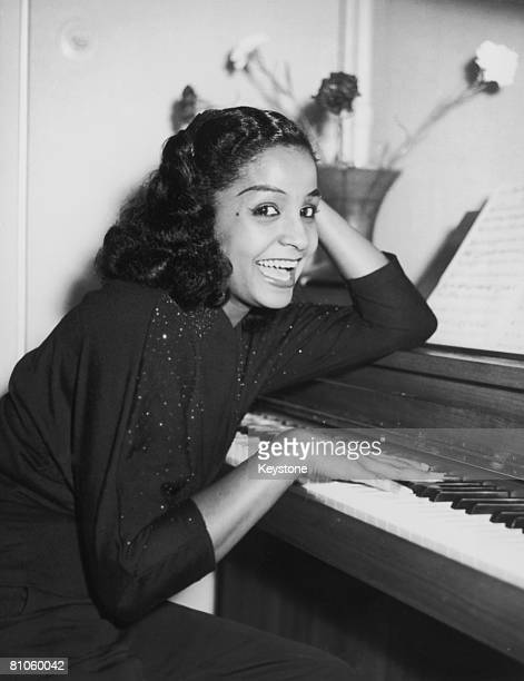 Trinidadborn singer Mona Baptiste prepares to leave Hamburg for a visit to London 13th September 1956