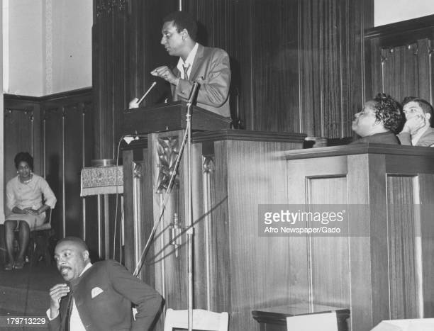 Trinidadianborn American Civil Rights activist Stokely Carmichael giving speech from podium with comeidian and fellow activist Dick Gregory also in...