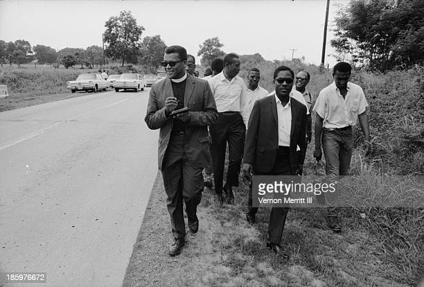 Trinidadianborn American Civil Rights leader Stokely Carmichael walks with others during a march to encourage voter registration Mississippi June 1966