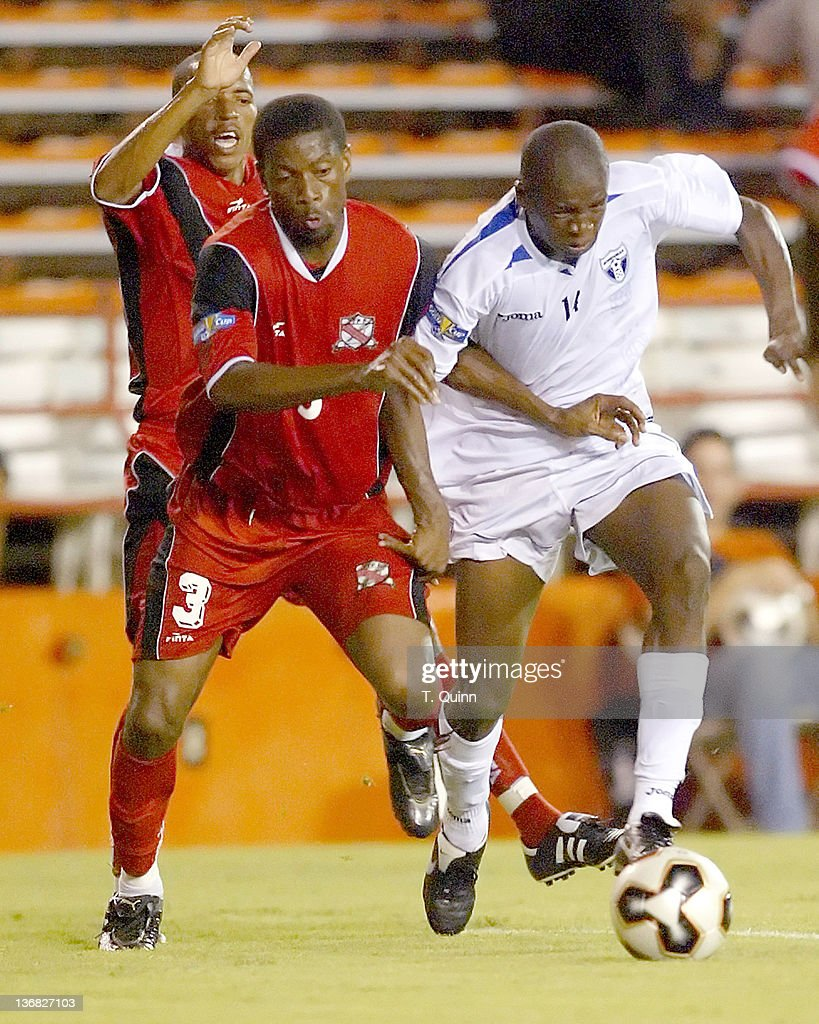 Trinidads #3 Emery John battles with Oscar Garcia during a match at the Orange Bowl, Miami, Florida, July 7 2005. The game ended in a 1-1 tie.