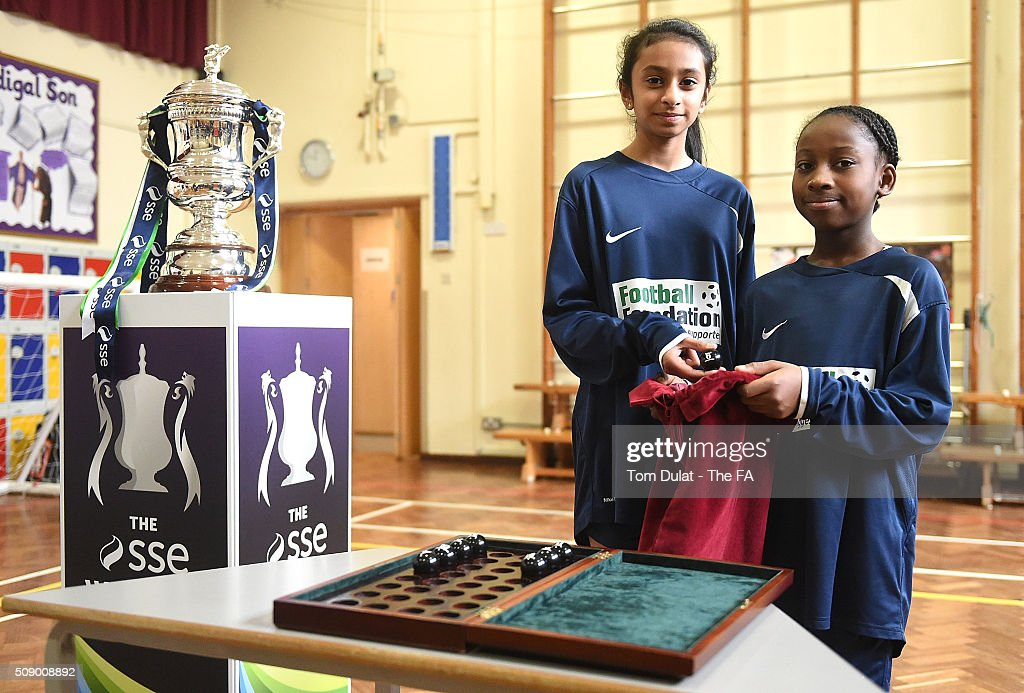 Trinity Campbell (R) and Anastasia Rosario (L) pose for photographs during the SSE Women's FA Cup Draw on February 8, 2016 in London, England. (Photo by Tom Dulat - The FA/The FA via Getty Images).