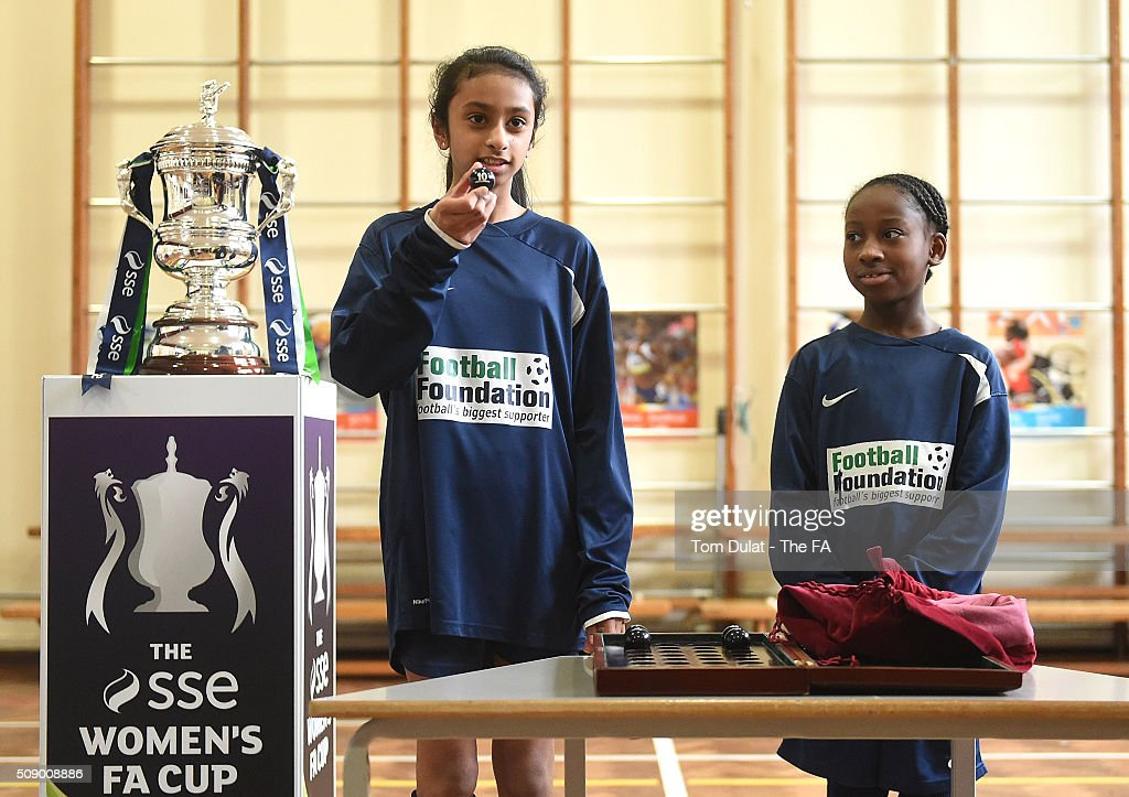 Trinity Campbell (R) and Anastasia Rosario (L) take part in the SSE Women's FA Cup Draw on February 8, 2016 in London, England. (Photo by Tom Dulat - The FA/The FA via Getty Images).