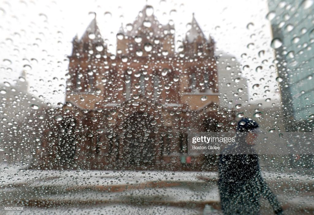 Trinity Church in Copley Square in Boston is seen through an early layer of sleet on glass as a winter storm arrives in the region on Mar. 14, 2017.
