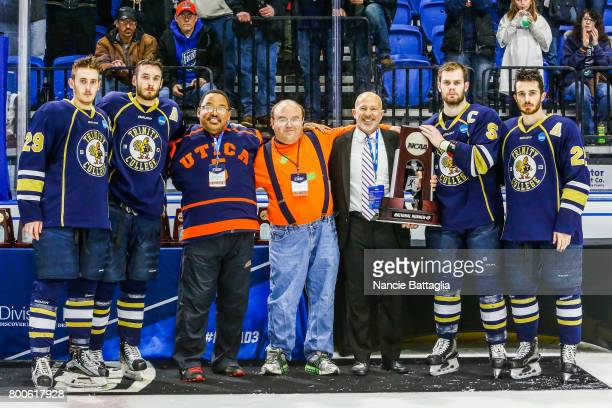 Trinity College captains and assistant captains pose for a photo it the second place trophy during the Division lll Men's Ice Hockey Championship...