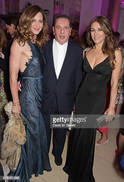 Trinny Woodall Charles Saatchi and Elizabeth Hurley attend the Spring Gala In Aid of the Red Cross War Memorial Children's Hospital hosted by QBF and...