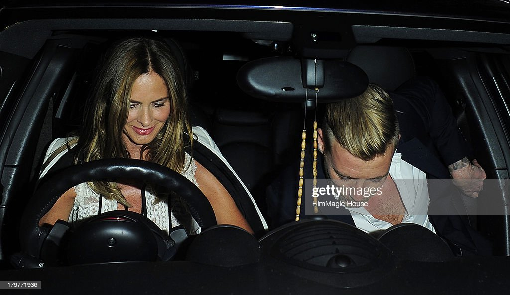 Trinny Woodall leaves Lulu Private Member's Club with a mystery younger man. on September 6, 2013 in London, England.