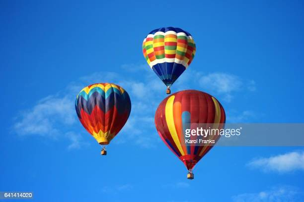 Trio of colorful hot air balloon soaring in the sky