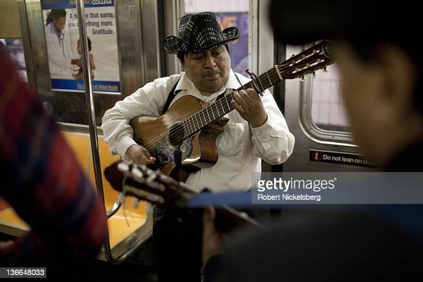 A trio of Hispanic musicians sing Feliz Navidad or 'Merry Christmas' to subway passengers December 23 2011 in Manhattan In 2010 New York's subway...