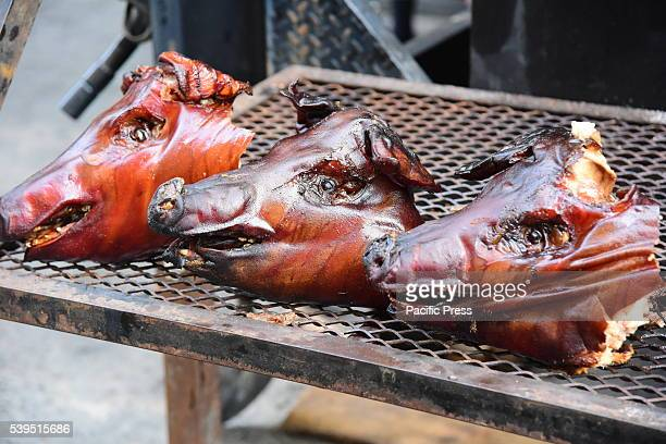 Trio of roasted pig heads on massive BBQ The annual Madison Square BBQ festival brought smoked specialists from all over the New York area to Midtown...