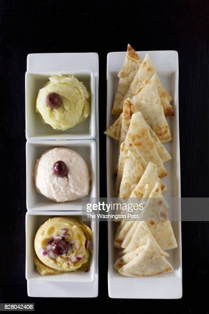 FALLS VA Trio of spreads from top to bottom Skordalia Taramosalata and Fava and pita bread at Our Mom Eugenia photographed in Great Falls VA