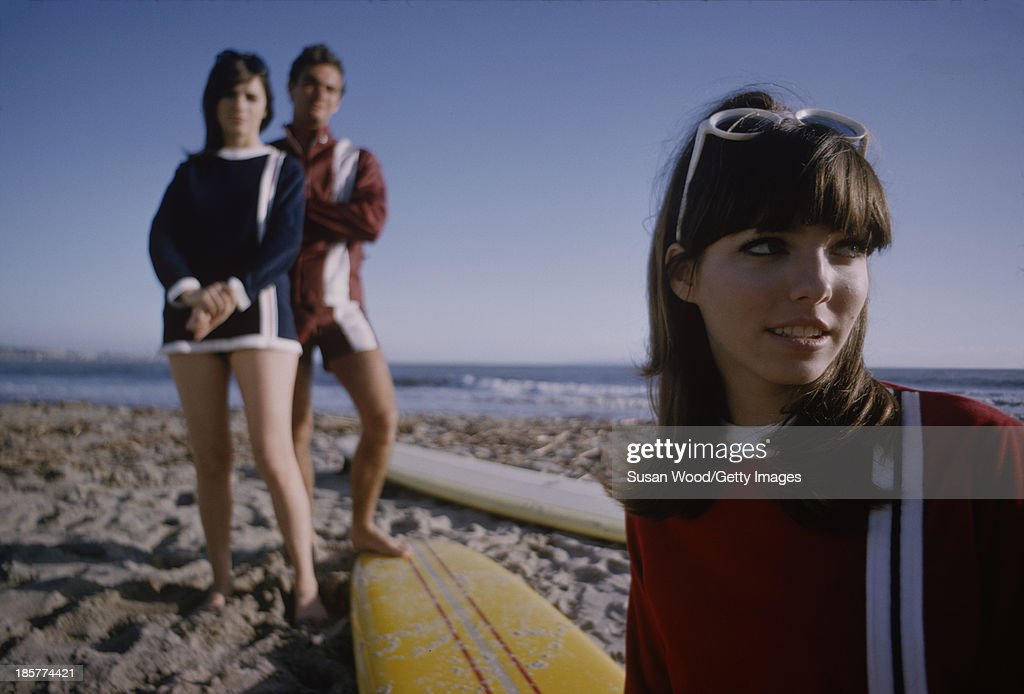 A trio of unidentified model posing with surfboards on the sand at Surfrider Beach, Malibu, California, January 1966. The photo was taken as part of a fashion shoot for Glamour Magazine.