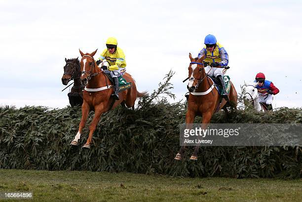 Triolo D'Alene ridden by Barry Geraghty next to Dunowen Point ridden by Jason Maguire on their way to winning the John Smith's Topham Chase during...