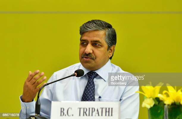 BC Tripathi chairman and managing director of GAIL India Ltd gestures while speaking during a news conference in New Delhi India on Monday May 22...
