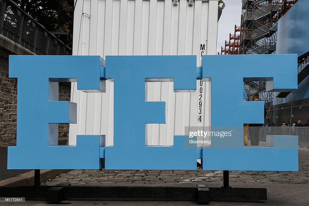 A 'Triple E' logo stands on the dockside during an open day for the Majestic Maersk Triple E class ship, one of the world's largest vessels, operated by A.P. Moeller-Maersk A/S at Langelinie pier in Copenhagen, Denmark, on Tuesday, Sept. 24, 2013. A.P. Moeller-Maersk A/S says it won't cut its investment in developing markets from Asia to South America even as creditors turn their backs. Photographer: Freya Ingrid Morales/Bloomberg via Getty Images