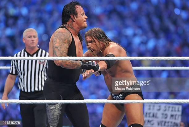 Triple H and The Undertaker Randy Orton and Triple H battle during their WWE match at 'WrestleMania 27' at the Georgia World Congress Center on April...