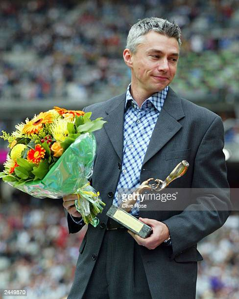 Triple jumper and world record holder Jonathan Edwards of Great Britain takes a moment during a ceremony honouring Edwards lifetime achievement at...