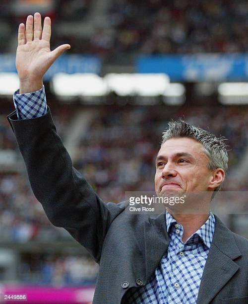 Triple jumper and world record holder Jonathan Edwards of Great Britain waves to the crowd during a ceremony honouring Edwards lifetime achievement...