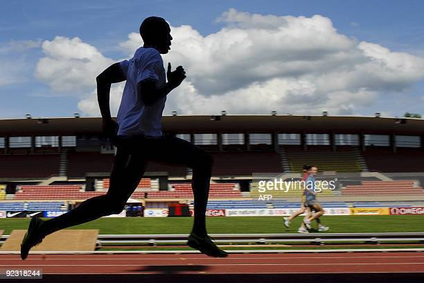 Triple Olympic gold medalist Usain Bolt of Jamaica is seen in silhouette during a practice session on July 6 2009 on the eve of the Super Grand Prix...