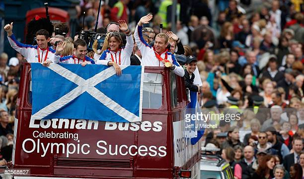 Triple Olympic gold medallist Chris Hoy cyclist Ross Edgar rower Katherine Granger and canoeist David Florence parade on a open top bus August 27...