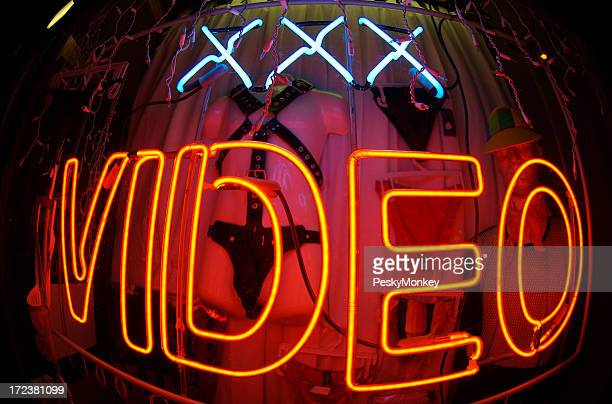 Triple X-Rated Video Bulge Neon Sign at Night