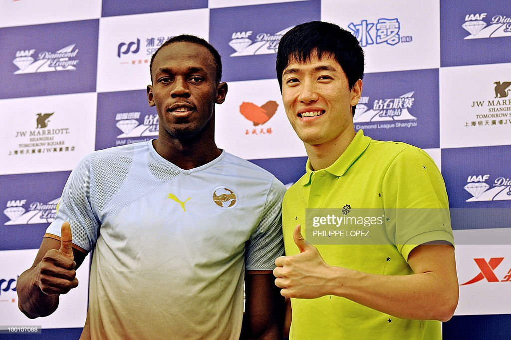 Triple-gold Olympic champion Jamaican sprinter Usain Bolt (L) and Chinese hurdler Liu Xiang pose during a press conference ahead of the IAAF Diamond League in Shanghai on May 21, 2010. Bolt returns to China for the first time since his triple-gold Olympic feat to launch his 200-metre season on while Chinese hurdler Liu Xiang looks for redemption in his hometown.