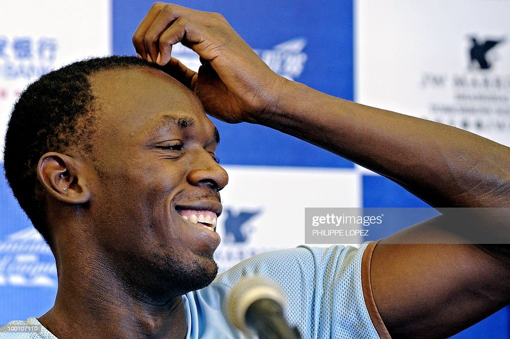 Triple-gold Olympic champion Jamaican sprinter Usain Bolt gestures during a press conference ahead of the IAAF Diamond League in Shanghai on May 21, 2010. Bolt returns to China for the first time since his triple-gold Olympic feat to launch his 200-metre season on while Chinese hurdler Liu Xiang looks for redemption in his hometown.