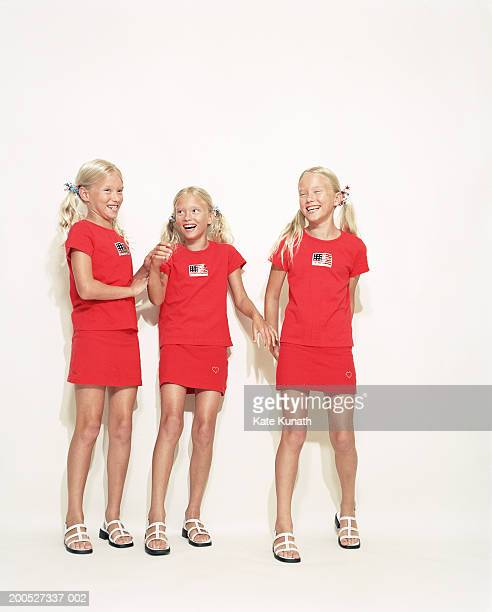 Triplet sisters (6-7) laughing