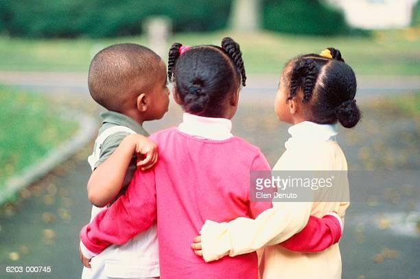Triplets Hugging