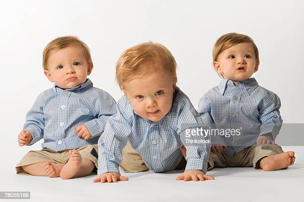 Triplets in button-down shirts