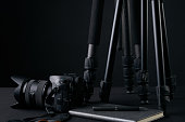 Tripods,notebook,pen and camera. Ready for filming or photo session. Photography equipment.