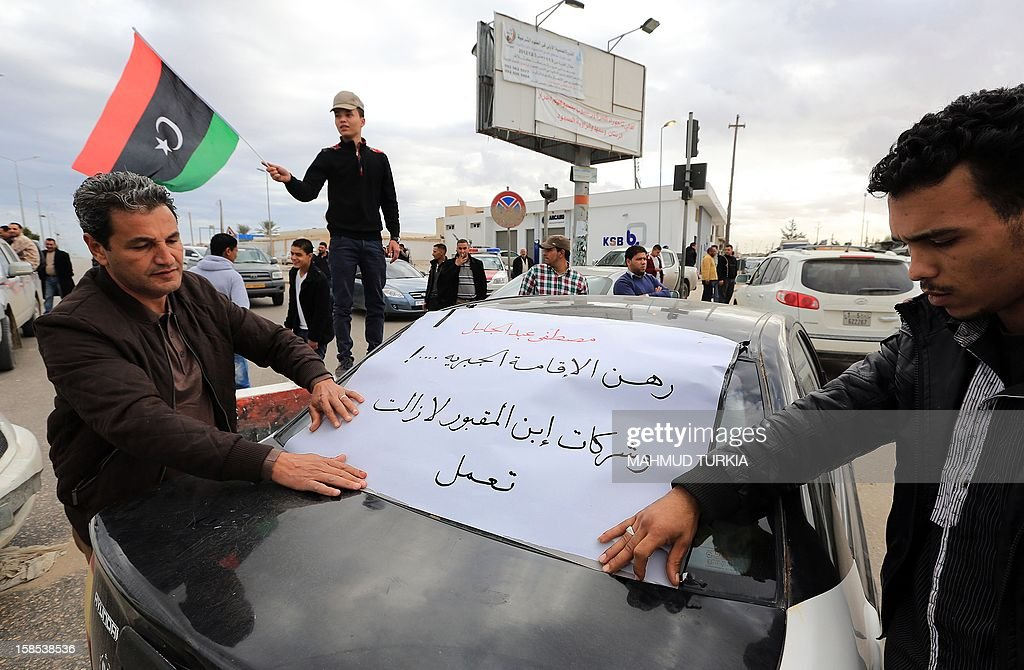 Tripoli residents block the roads as they demonstrate against the indictement of former Libyan National Council chairman Mustafa Abdel Jalil for the murder of former Rebels Chief of Staff Abdel Fatah Younis on December 18, 2012 in Tripoli, Libya.