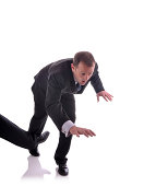 Image of a business man being tripped up