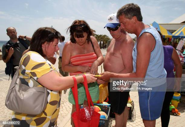 Trish Cameron sister of Kate McCann hands out badges and armbands to members of the public in Praia Da Luz on the first anniversary of Madeleine...