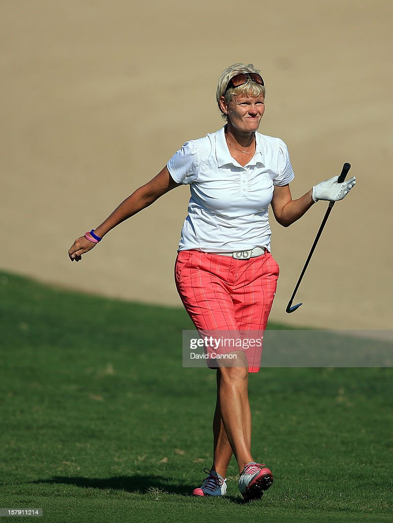 Trish Johnson of England plays her second shot at the par 4, 14th hole during the third round of the 2012 Omega Dubai Ladies Masters on the Majilis Course at the Emirates Golf Club on December 7, 2012 in Dubai, United Arab Emirates.