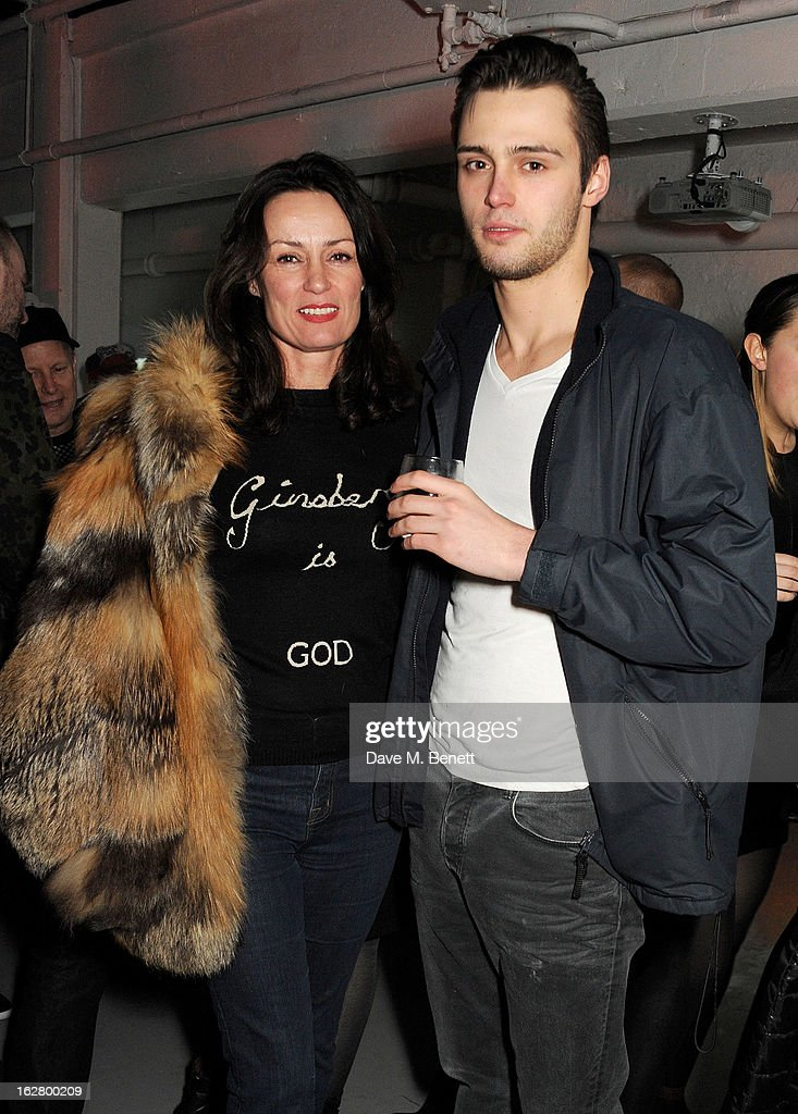 Trish Simonon (L) and son Claude Simonon attend the launch of artist Dinos Chapman's first album 'Luftbobler' at The Vinyl Factory on February 27, 2013 in London, England.