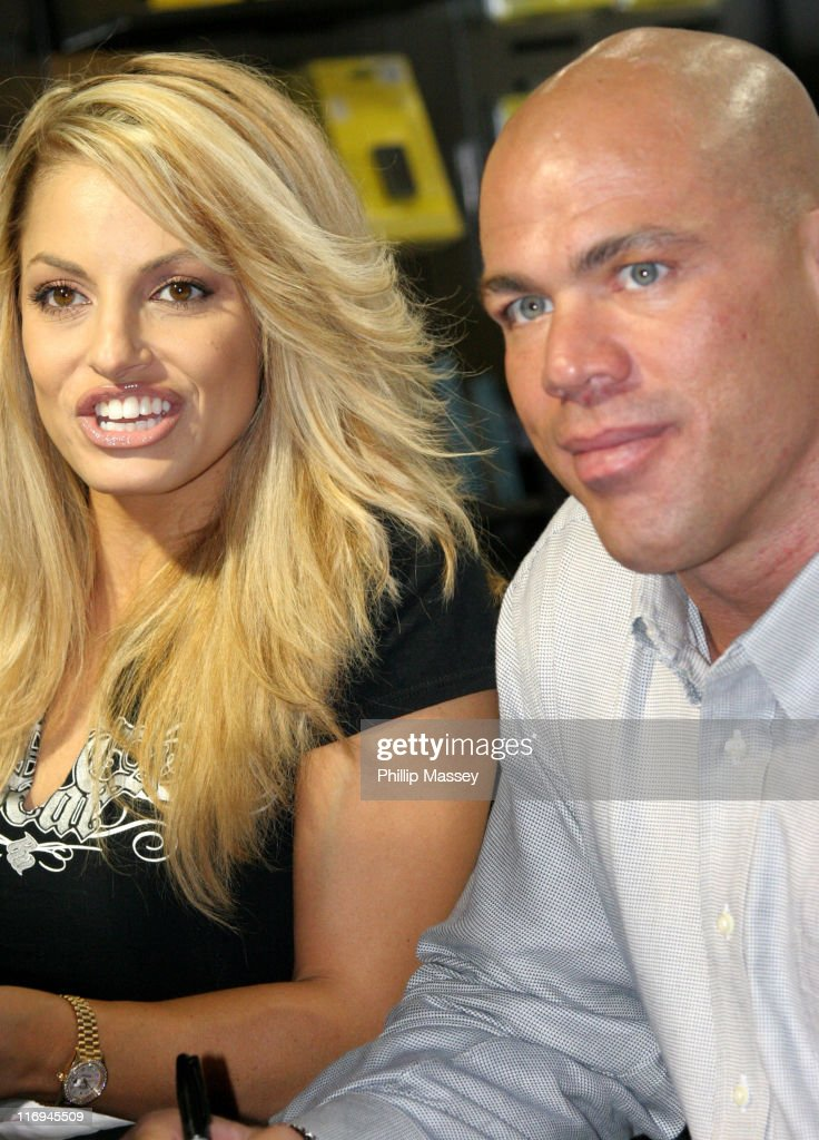 Trish Stratus and <a gi-track='captionPersonalityLinkClicked' href=/galleries/search?phrase=Kurt+Angle&family=editorial&specificpeople=644134 ng-click='$event.stopPropagation()'>Kurt Angle</a> during WWE Wrestlers Trish Stratus and <a gi-track='captionPersonalityLinkClicked' href=/galleries/search?phrase=Kurt+Angle&family=editorial&specificpeople=644134 ng-click='$event.stopPropagation()'>Kurt Angle</a> Sign Their DVD at HMV in Dublin - November 20, 2005 at HMV Dublin in Dublin, Ireland.