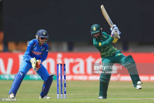 Trisha Chetty of South Africa hits the ball towards the boundary as Sushma Verma of India looks on during the ICC Women's World Cup 2017 match...