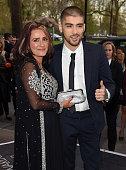 Trisha Malik and Zayn Malik attend The Asian Awards 2015 at The Grosvenor House Hotel on April 17 2015 in London England