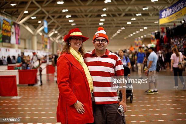 TORONTO ON SEPTEMBER 4 Trisha Murphy dressed as Carmen Sandiego and Matt Murphy dressed as Waldo pose for a photo at the Fan Expo in Toronto...