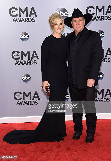 Trisha Yearwood and Garth Brooks attend the 48th annual CMA Awards at the Bridgestone Arena on November 5 2014 in Nashville Tennessee