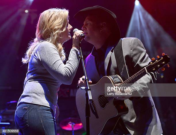 Trisha Yearwood and Garth Brooks perform during Playin' Possum The Final No Show Tribute To George Jones Show at Bridgestone Arena on November 22...