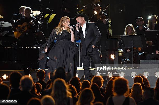 Trisha Yearwood and Garth Brooks perform onstage at the 50th annual CMA Awards at the Bridgestone Arena on November 2 2016 in Nashville Tennessee