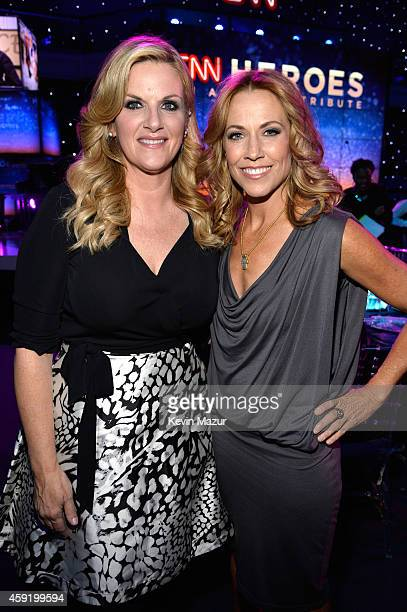 Trisha Yearwood and Sheryl Crow attend the 2014 CNN Heroes An All Star Tribute at American Museum of Natural History on November 18 2014 in New York...