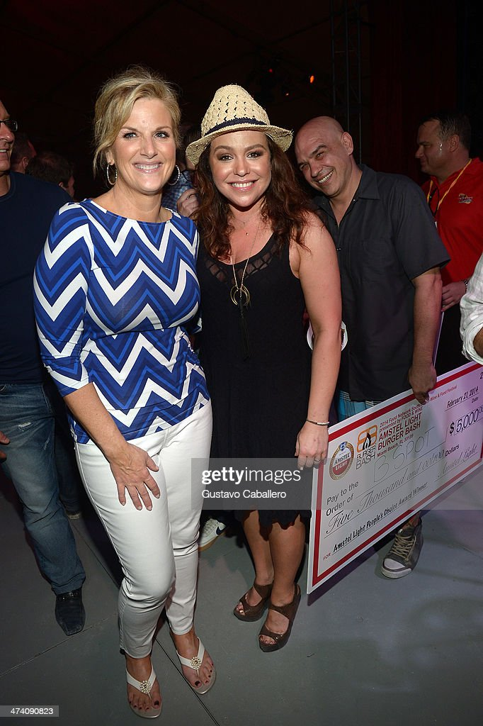 Trisha Yearwood and TV Personality Rachael Ray attend Amstel Light Burger Bash presented by Pat LaFrieda Meats hosted by Rachael Ray during the Food Network South Beach Wine & Food Festival at Beachside at The Ritz Carlton on February 21, 2014 in Miami Beach, Florida.