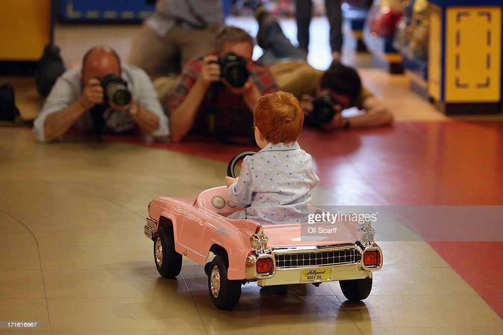 Tristan, aged 2, is photographed as he rides a 'Hollywood Pedal Car' in Hamleys toy shop on June 27, 2013 in London, England. The car, which retails for 250 GBP and is a replica of a 1959 pink Cadillac, is included in Hamleys' predictions for the top selling toys for Christmas 2013.