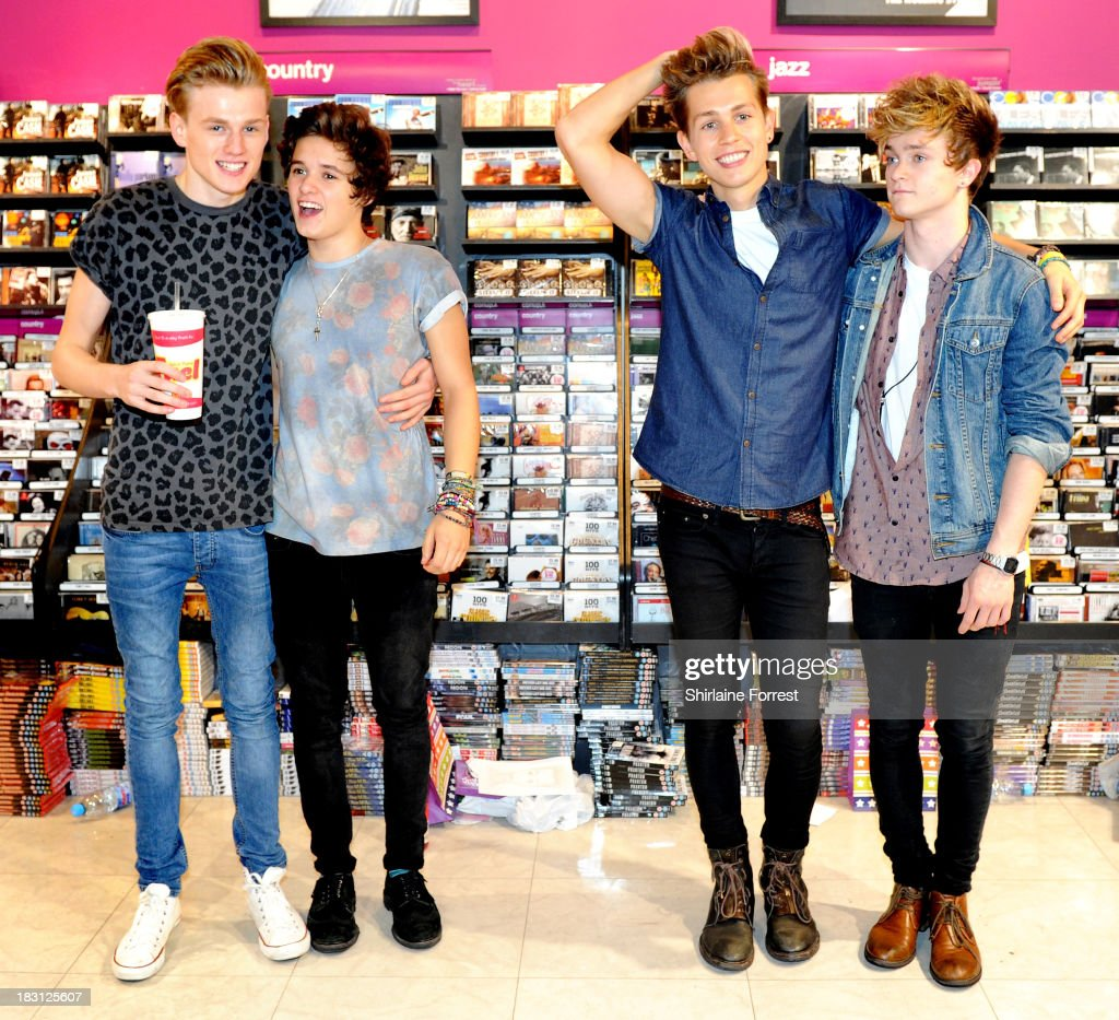 Tristan Evans, Bradley Simpson, James McVey and Connor Ball of The Vamps sign copies of their new single 'Can We Dance' at HMV Birmingham Bullring on October 4, 2013 in Birmingham, England.