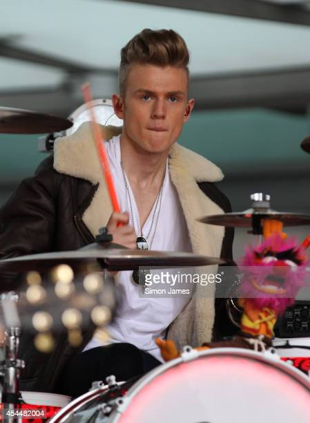 Tristan Evans of The Vamps performing outside the BBC building for the One Show on September 1 2014 in London England
