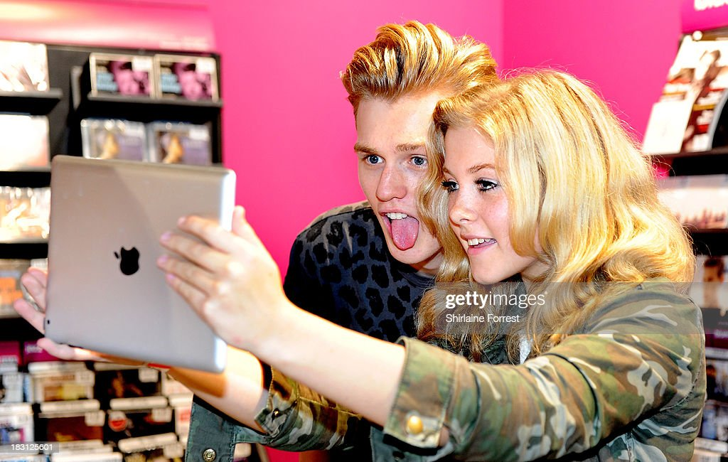 Tristan Evans of The Vamps signs copies of their new single 'Can We Dance' at HMV Birmingham Bullring on October 4, 2013 in Birmingham, England.