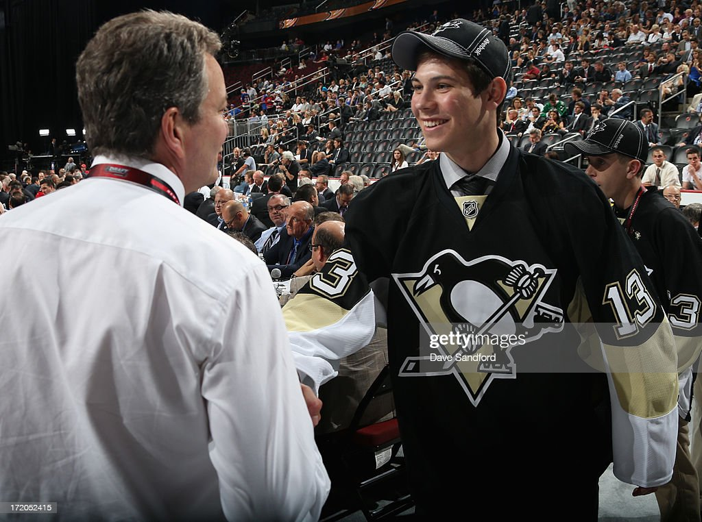 Tristan Jarry greets general manager Ray Shero after being selected 44th overall by the Pittsburgh Penguins during the 2013 NHL Draft at Prudential Center on June 30, 2013 in Newark, New Jersey.