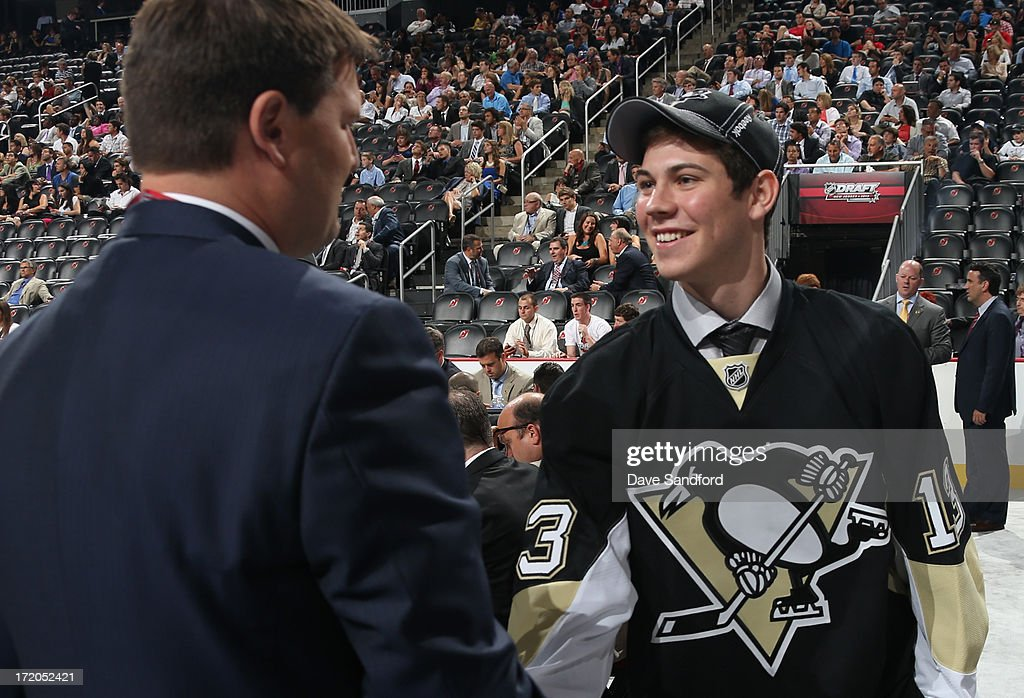 Tristan Jarry greets the team after being selected 44th overall by the Pittsburgh Penguins during the 2013 NHL Draft at Prudential Center on June 30, 2013 in Newark, New Jersey.